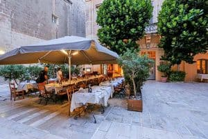 The outdoor terrace at Trattoria AD 1530 in Mdina.