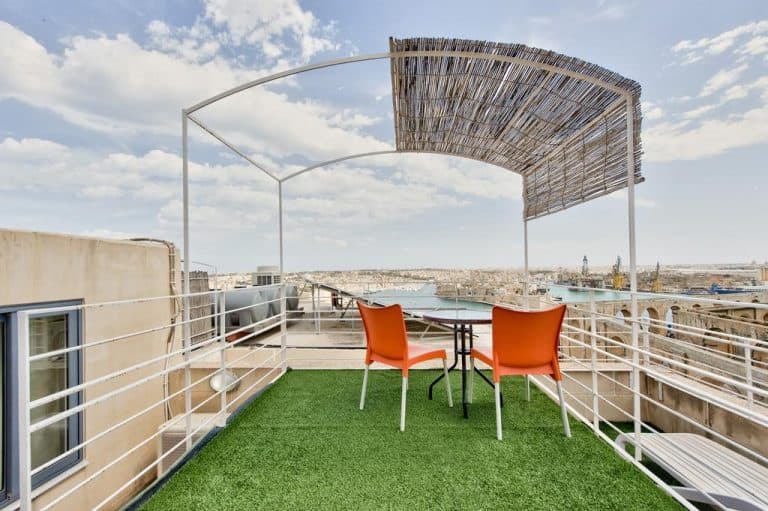 Outdoor terrace on the roof with harbour views at Barrakka Suites.