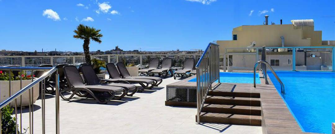The Bayview Sliema Hotel and Apartments rooftop pool and sundeck.
