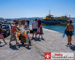 Passengers queuing up for their boat trip to the Blue Lagoon with Sea Adventure Excursions.