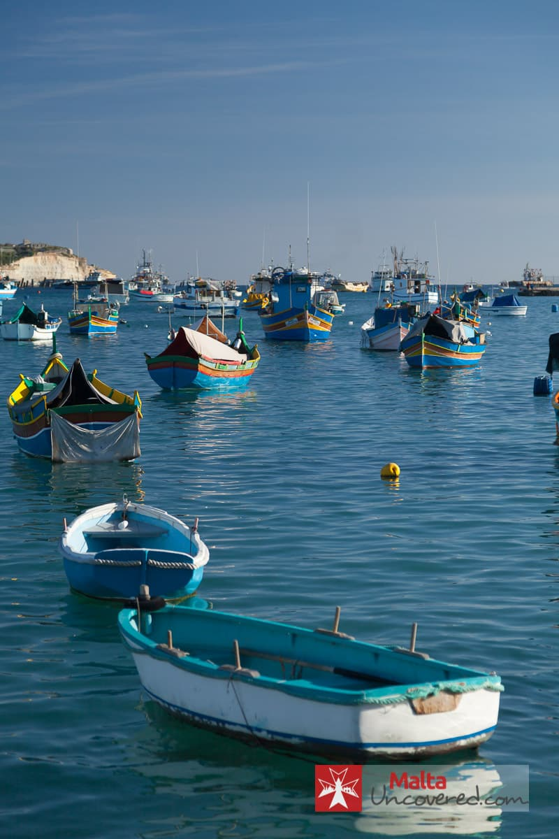 Marsaxlokk harbour is full of fishing boats.