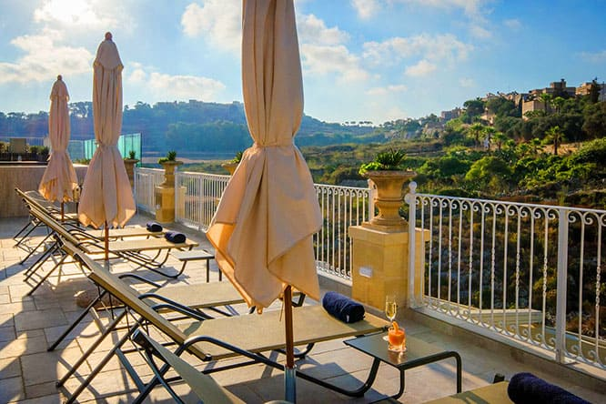 Valley views from the terrace and outdoor pool at Cesca Boutique Hotel, one of the more peaceful Gozo hotels.