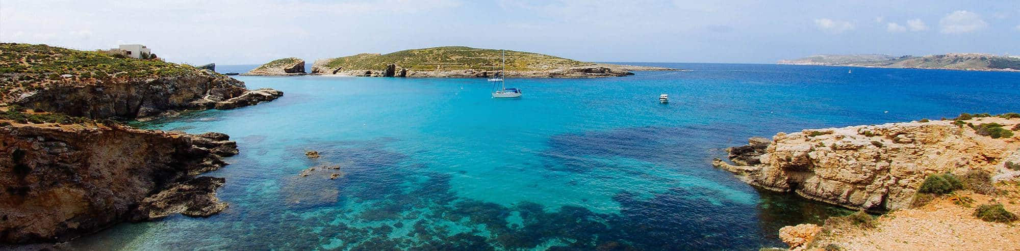 Malta holidays with a view of Comino's most popular attraction: The Blue Lagoon. Photo by Flavio Ensiki