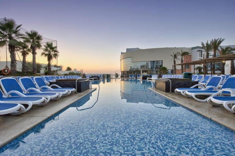 Outdoor pool with sea view at the DB San Antonio Hotel & Spa.