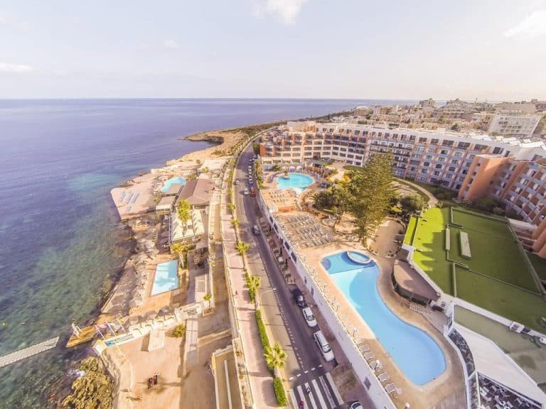 Aerial view of the Dolmen Hotel Malta and the seafront at Qawra.
