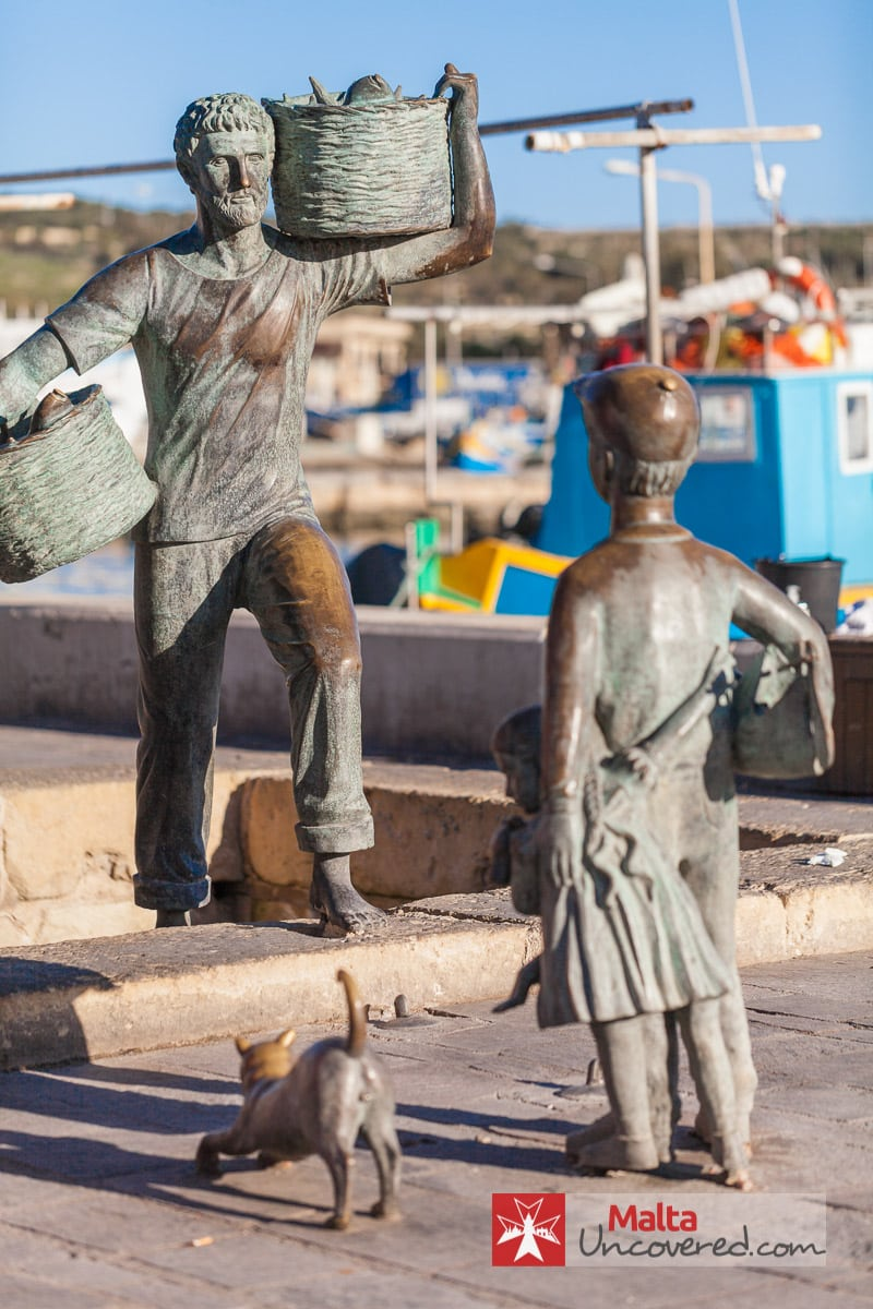 A statue on the promenade of this traditional fishing village.