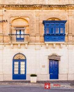 Facade of a traditional Maltese townhouse at the square of Mellieħa.