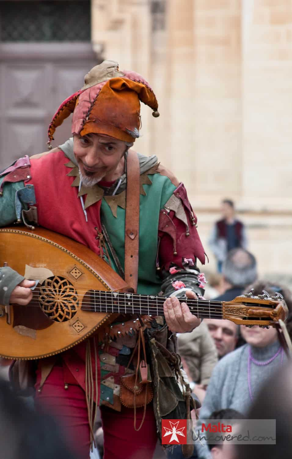 A (re-enacting) jester entertains the crowd at Medieval Mdina