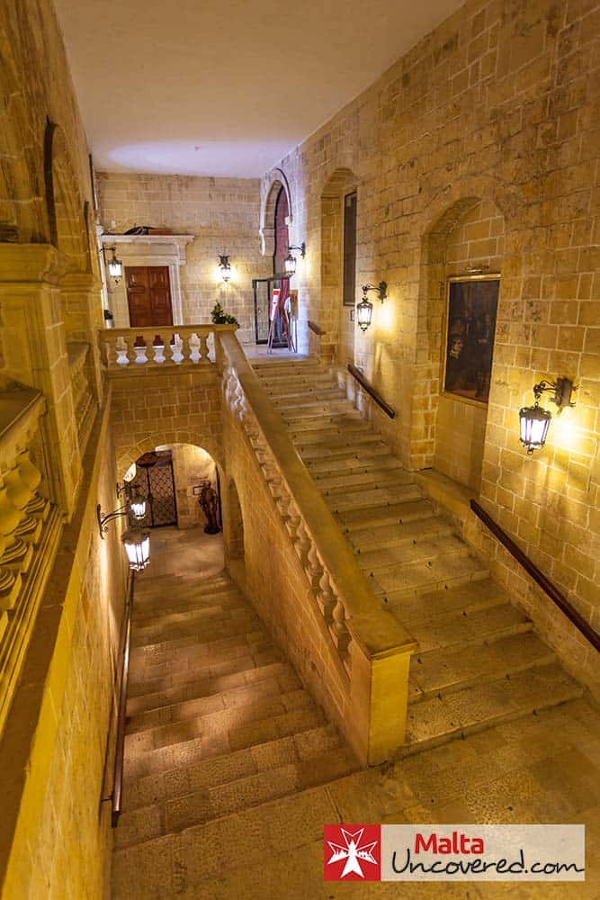 The shallow staircase inside La Sacra Infermeria that takes you down to the main ward.