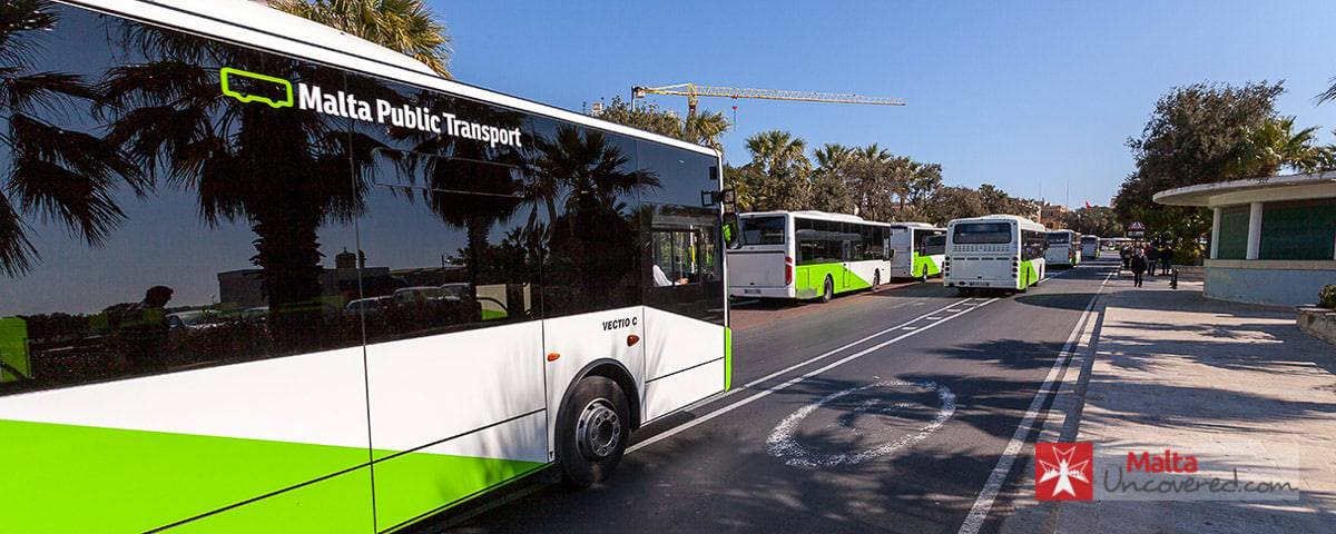 A Malta Public Transport bus driving towards Valletta bus terminus.
