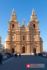 The Mellieħa church seen from its square.