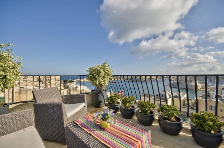 Outdoor terrace with harbour views at Palazzo Prince d'Orange.