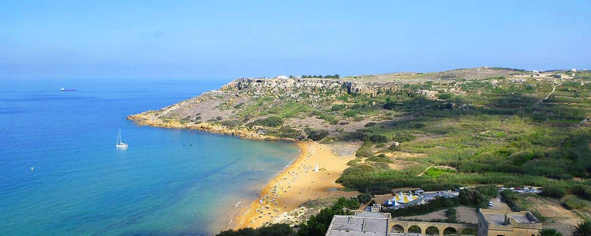 Ramla l-Hamra beach in Gozo, viewed from the west