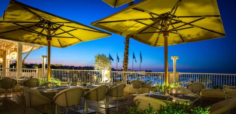 Salini Resort terrace and dining area with sea view.