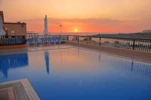 The rooftop pool of the Soreda Hotel at sunset.