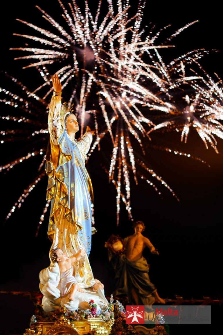 Festa at Mgarr, Malta with a statue of the Holy Mary during the procession.