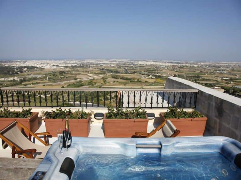 Luxury at the Xara Palace: A terrace with jacuzzi overlooking half of Malta.